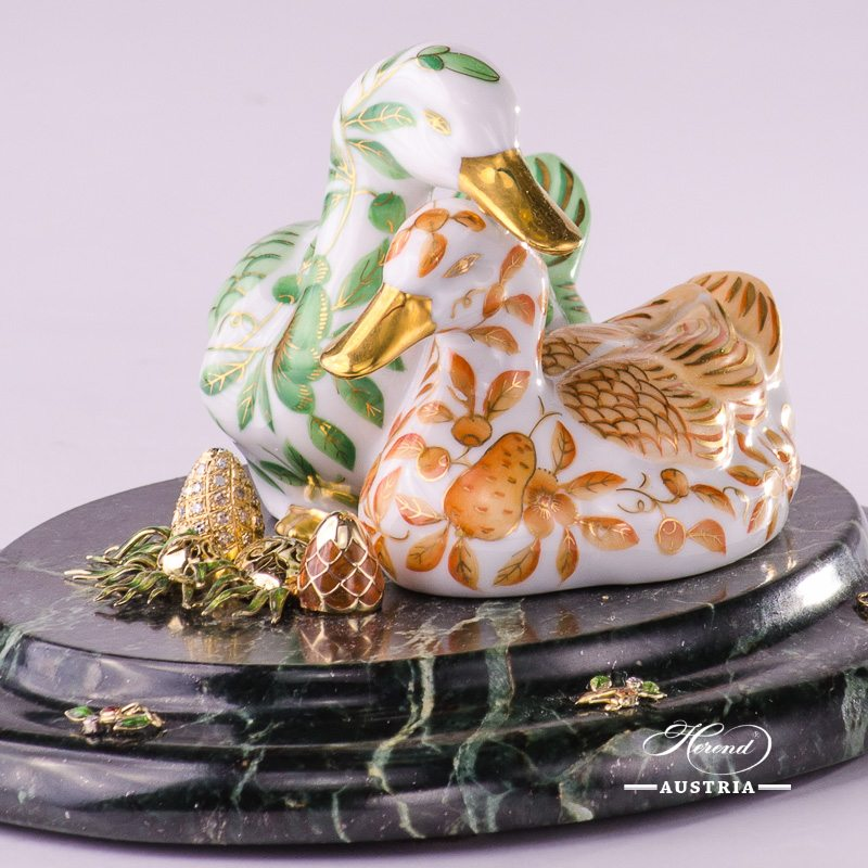 Jewelled Pair of Ducks 5036-0-00 ZOVA-ZO Special Green and Orange pattern. Herend fine china. Hand painted ornaments. Jewelled Pair of Ducks standing on green marble base with 2 pieces of Eggs. Jewelled with: 14 karat Gold - Au 585: 16.2 grams